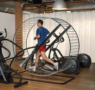 Man running in a giant hamster wheel
